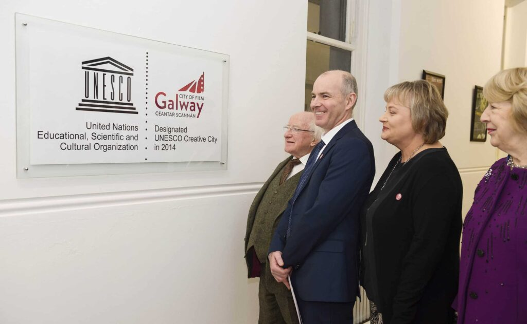 President, Declan, Sabina & Celine at glass sign